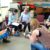 A group of students sit in a circle working on the Thumbjam apps on their iPads at a training day.